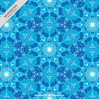 少しの幾何学的な結晶を有する青色の背景
