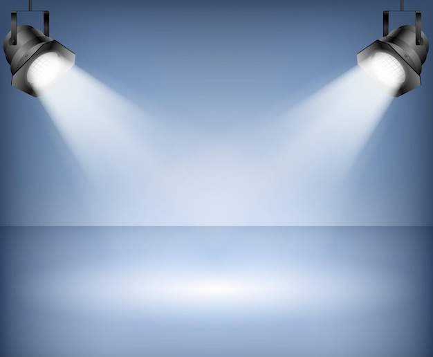 Blue background with spotlights Premium Vector