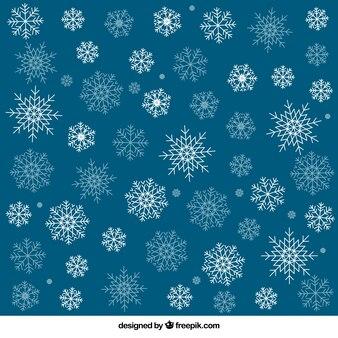 Голубой фон с белыми снежинками