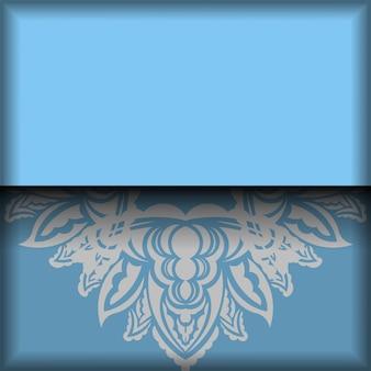 ヴィンテージの白い装飾品とあなたのロゴのためのスペースと青いバナーテンプレート
