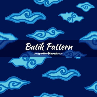 Blue batik background of hand drawn clouds