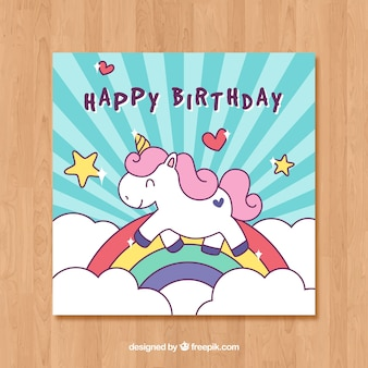Blue birthday card template with a unicorn