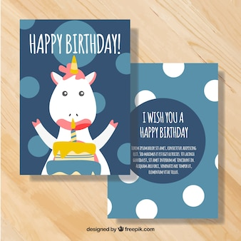 Blue birthday card with cute unicorn and circles