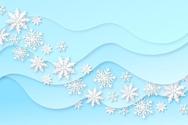 Blue blurry winter background with snowflakes