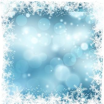 Синий боке фон со снежинками