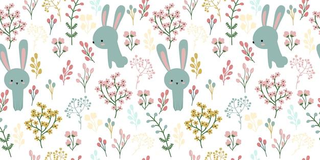 青いウサギとシームレスなパターンの花のイラスト