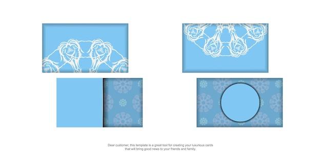 あなたの連絡先のためのヴィンテージの白い飾りが付いた青い名刺。