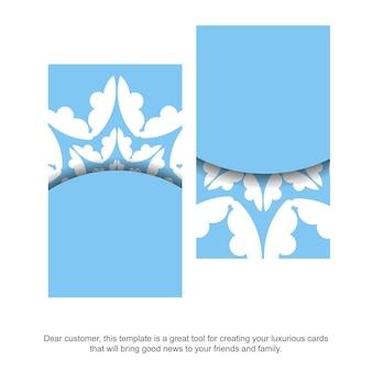 あなたのブランドのヴィンテージの白い装飾品が付いた青い名刺。
