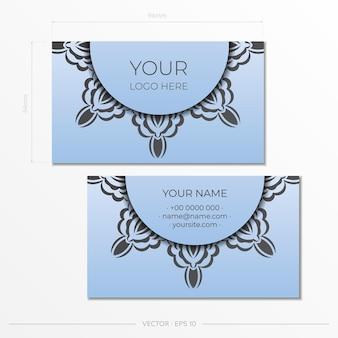 豪華な黒い装飾が施された青い名刺。ヴィンテージパターンの名刺デザイン。