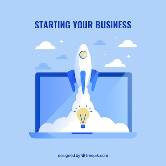 Blue business concept with laptop and rocket