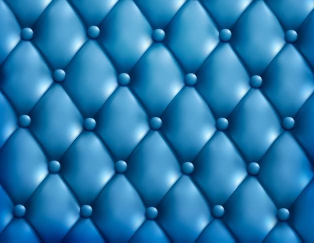 青いボタン房状の革の背景。