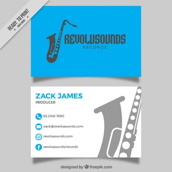Blue card of music studio with saxophone silhouette