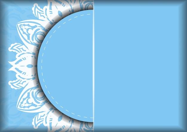 Синяя карта с белым орнаментом мандалы для вашего бренда.