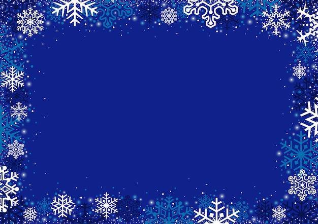 雪片と青いクリスマスの背景