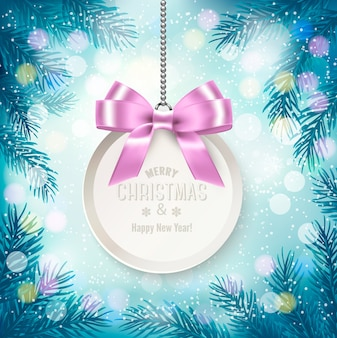 Blue christmas background with tree branches and gift card