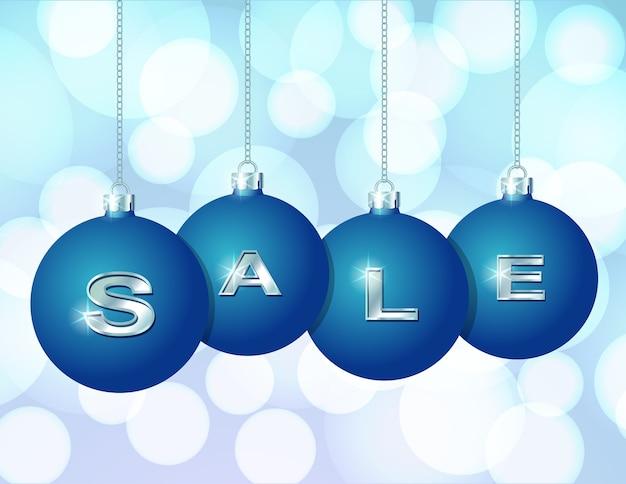 Синие новогодние шары, висящие на серебряных цепях с написанным на них серебряным словом продажа