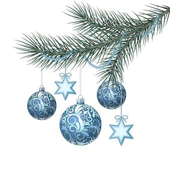 緑の小ぎれいなな枝に青いクリスマスボール。図