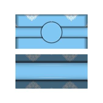 タイポグラフィ用に用意された抽象的な白い飾りと青い色のパンフレットテンプレート。