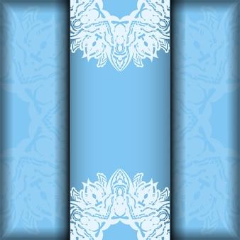 Карточка синего цвета с винтажным белым узором для вашего дизайна.