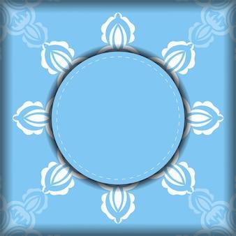 タイポグラフィ用に用意された豪華な白い模様の青いチラシ。
