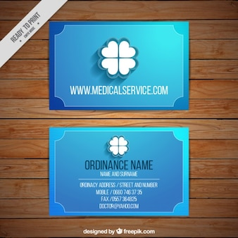 Blue corporative card with a clover Free Vector
