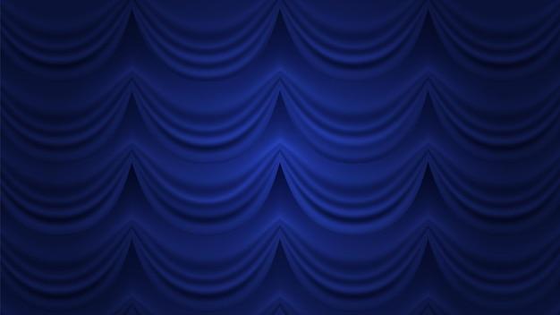 青いカーテン。閉じたカーテンの背景。劇場サーカスホールステージ用の青いカーテン。