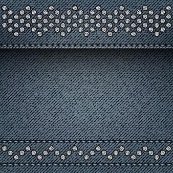 ステッチとシルバーのスパンコールラインが付いた青いデニムの背景。