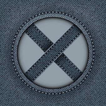 둥근 프레임과 십자 줄무늬가 있는 파란색 데님 배너 안에 바늘이 있습니다.