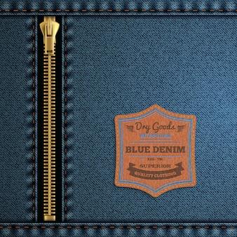 ジッパーとラベルの背景を持つ青いデニム布