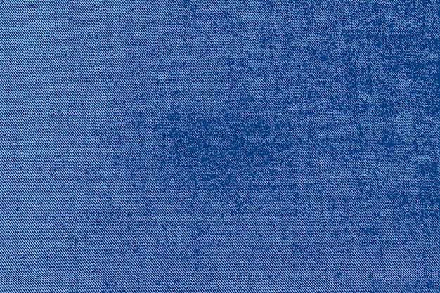 Голубая джинсовая ткань текстуры фона. векторный фон.