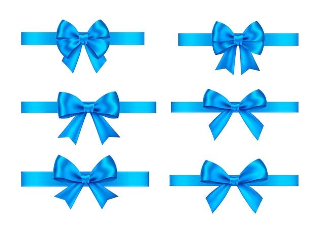 白で隔離される青いギフト弓セット