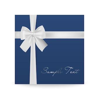 白で隔離の白い弓と青いグリーティングカード