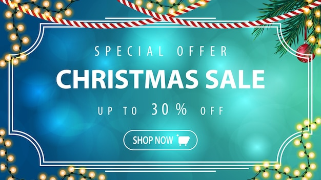 Blue horizontal discount banner with garland and christmas tree branch