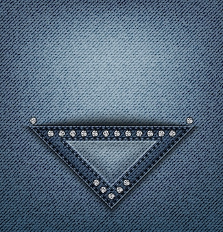 Blue jeans triangle design with stitches and sequins on denim.