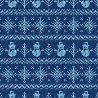 Синий вязаный фон со снеговиками и снежинками.