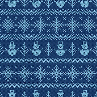 Blue knitted seamless pattern with snowmen and snowflakes.