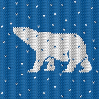 Blue knitted winter blue seamless pattern with polar bear with snow