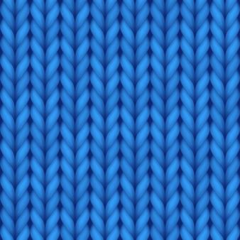 壁紙デザインのための青い編み物のシームレスな背景