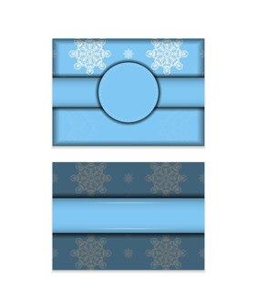 タイポグラフィ用に用意された曼荼羅の白い飾りが付いた青いリーフレット。