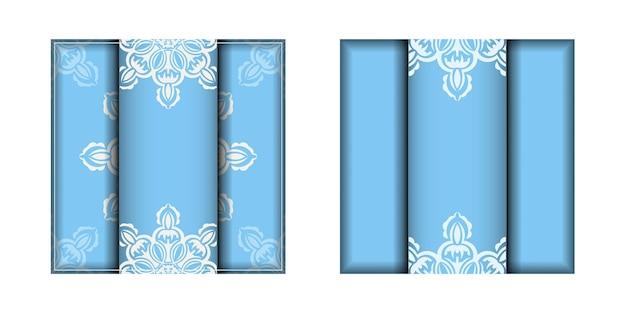 印刷の準備ができている白い曼荼羅の装飾品が付いている青いリーフレット。