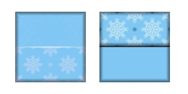 印刷用に用意された白い曼荼羅模様の青いリーフレット。