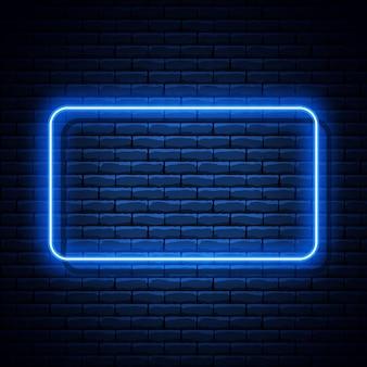 Голубая неоновая прямоугольная рамка на кирпичной стене.