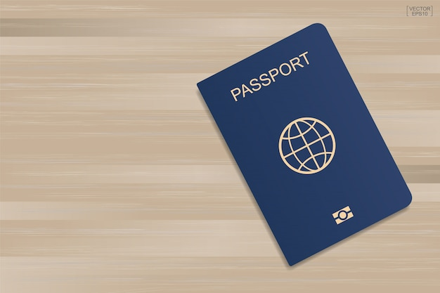 Blue passport on wood background.