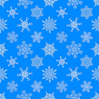 Blue pattern with drawn snowflakes