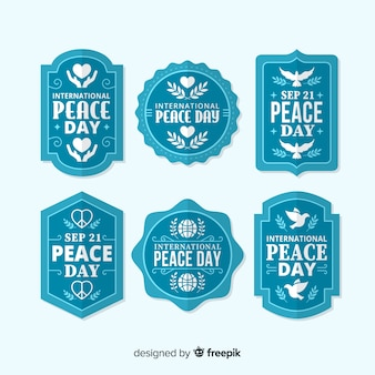 Blue peace day badge collection in flat design