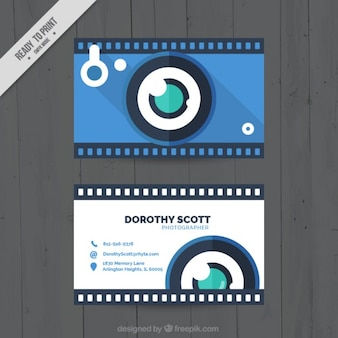 Blue photo camera, business card