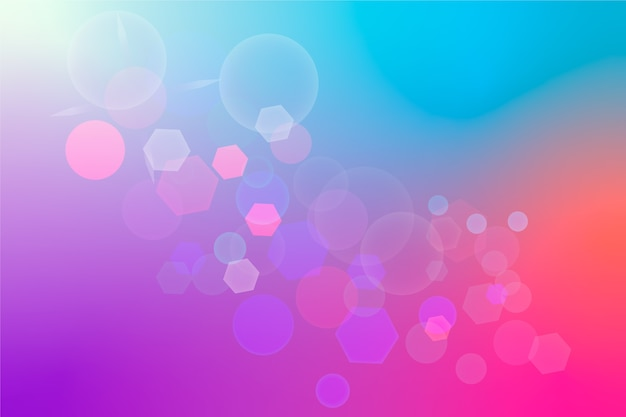 Blue and pink gradient background with bokeh effect