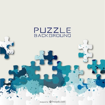 Blue puzzle pieces and paint splashes background