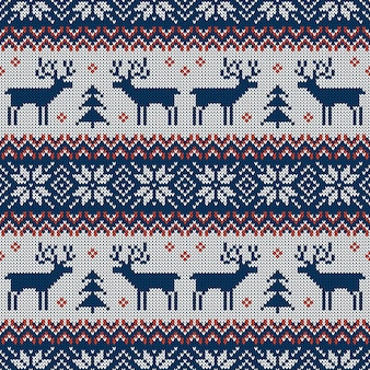 Blue and red knitted seamless pattern with deers and traditional scandinavian ornament.