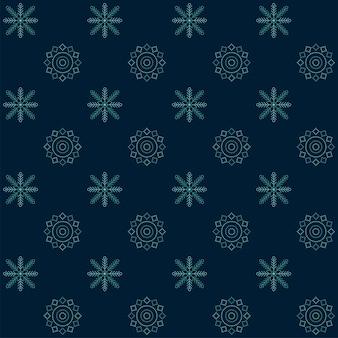 青いシームレスな雪片と曼荼羅パターンの背景。